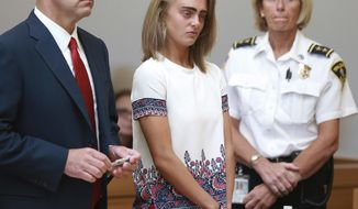 FILE - In this Aug. 3, 2017, file photo, Michelle Carter listens to her sentencing for involuntary manslaughter for encouraging 18-year-old Conrad Roy III to kill himself in July 2014. At left is her defense attorney Joseph Cataldo. Carter was sentenced to 15 months in jail. The Massachusetts Supreme Judicial Court notified attorneys Wednesday, March 14, 2018, that it has agreed to hear Carter's appeal. (Matt West/The Boston Herald via AP, Pool, File)