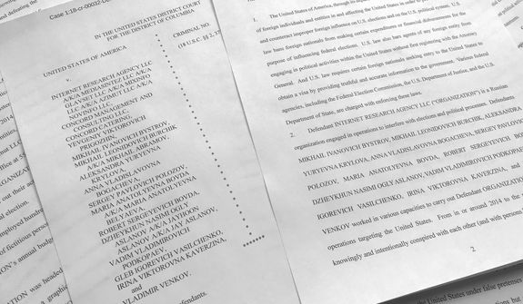 In this March 15, 2018, photo, a portion of the Feb. 16, indictment against Russia's Internet Research Agency is photographed in Washington. (AP Photo/Jon Elswick)
