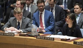 British Deputy Ambassador to the United Nations Jonathan Allen, right, listens as American Ambassador to the United Nations Nikki Haley speaks during a Security Council meeting on the situation between Britain and Russia, Wednesday, March 14, 2018, at United Nations headquarters. (AP Photo/Mary Altaffer) ** FILE **