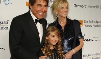 FILE - This Saturday, Oct. 11, 2008 file photo shows Steve Wynn, left, his wife Elaine Wynn, right, and their granddaughter Marlowe Early arrive at the Andre Agassi Charitable Foundation's 13th Grand Slam for Children benefit show at the Wynn Las Vegas hotel and casino in Las Vegas. An agreement involving embattled casino mogul Steve Wynn and his ex-wife that has kept her from controlling her stock in Las Vegas-based Wynn Resorts has been deemed invalid. A state judge in Las Vegas on Wednesday, March 14, 2018, signed off on a stipulation and order stating that the 2010 stockholders agreement is no longer enforceable.  (AP Photo/Isaac Brekken, File)