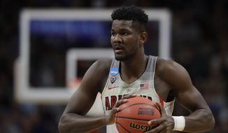 Arizona forward Deandre Ayton holds the ball against Buffalo during the first half of a first-round game in the NCAA men's college basketball tournament Thursday, March 15, 2018, in Boise, Idaho. (AP Photo/Ted S. Warren) **FILE**