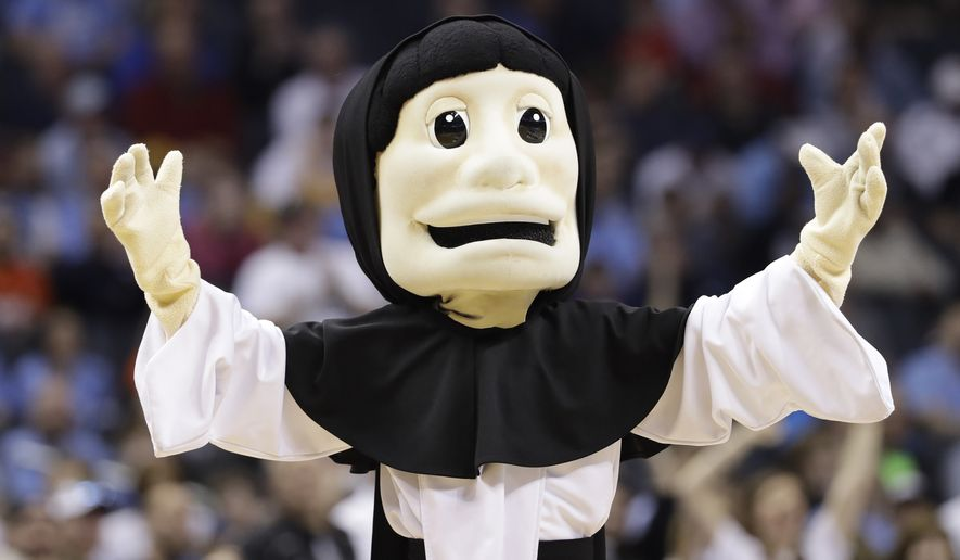 The Providence mascot performs during the first half of a first-round game against Texas A&M in the NCAA men's college basketball tournament in Charlotte, N.C., Friday, March 16, 2018. (AP Photo/Gerry Broome)