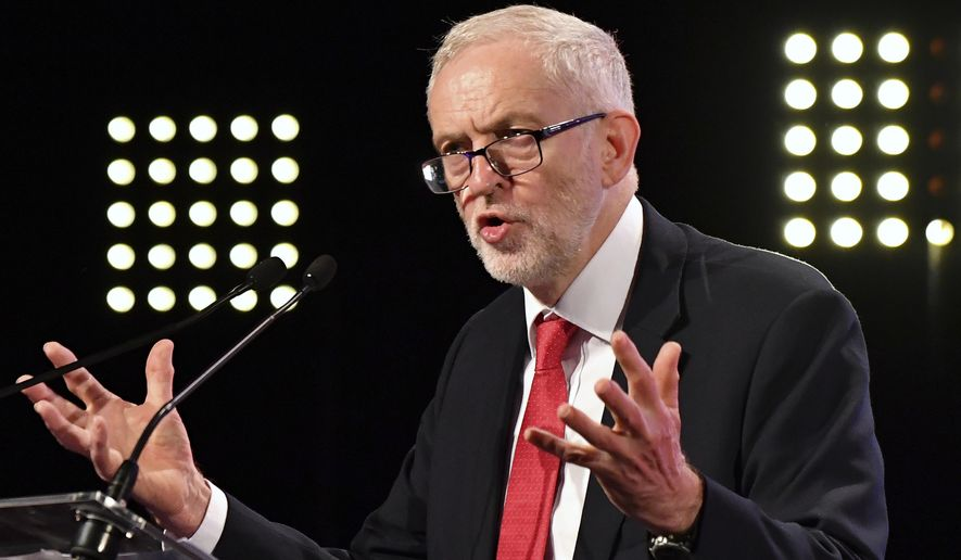 FILE - In this Thursday, Oct. 19, 2017 file photo, Britain's Labour Party leader Jeremy Corbyn delivers a speech prior to a meeting of European Socialists prior to an EU summit in Brussels. The United States and other allies have united behind the U.K. government in blaming Russia for the nerve-agent poisoning of former spy Sergei Skripal and his daughter Yulia. But Britain's main opposition party is split over how firmly to point the finger at Moscow. (AP Photo/Geert Vanden Wijngaert, file)