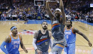 Oklahoma City Thunder forward Corey Brewer (3) dunks in front of teammate Steven Adams (12) and Los Angeles Clippers forward Tobias Harris (34) and center DeAndre Jordan (6) in the first half of an NBA basketball game in Oklahoma City, Friday, March 16, 2018. (AP Photo/Sue Ogrocki)