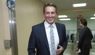 In this Feb. 9, 2018, file photo, Sen. Jeff Flake, R-Ariz., walks to the Senate chamber for early morning votes at Capitol Hill in Washington. Flake has a direct message for the Republicans of New Hampshire: Someone needs to stop Donald Trump. And Flake, a Republican senator from Arizona, may stand up against the Republican president in 2020, either as a Republican or an independent, if no one else does. (AP Photo/Jose Luis Magana, File)