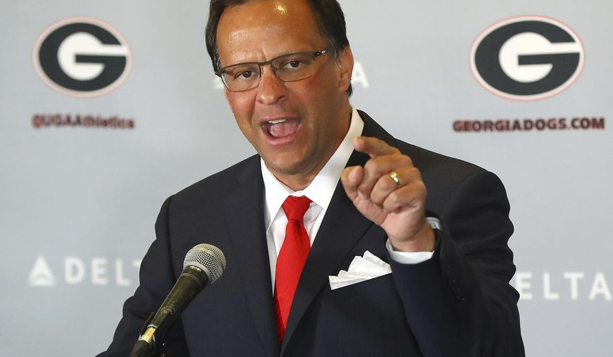 Georgia's new men's basketball coach Tom Crean speaks after being introduced during an NCAA college basketball news conference, Friday, March 16, 2018, at Stegeman Coliseum in Athens, Ga. (Curtis Compton/Atlanta Journal-Constitution via AP)