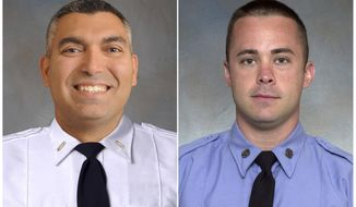"""This combination of two undated photos provided by the New York City Fire Department shows FDNY Lt. Christopher J. Raguso, left, and FDNY Fire Marshal Christopher """"Tripp"""" Zanetis. The men are among the seven service members killed when their military helicopter crashed in Iraq. (New York City Fire Department via AP)"""