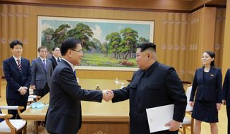 "FILE - In this March 5, 2018 file photo, provided by the North Korean government, North Korean leader Kim Jong Un, front right, shakes hands with South Korean National Security Director Chung Eui-yong after Chung gave Kim the letter from South Korean President Moon Jae-in, in Pyongyang, North Korea. South Korean President Moon Jae-in has always wanted to lead the diplomacy aimed at ending the North Korean nuclear crisis, even as he was overshadowed in his first year in office by a belligerent standoff between Donald Trump and Kim Jong Un. Independent journalists were not given access to cover the event depicted in this image distributed by the North Korean government. The content of this image is as provided and cannot be independently verified. Korean language watermark on image as provided by source reads: ""KCNA"" which is the abbreviation for Korean Central News Agency. (Korean Central News Agency/Korea News Service via AP, File) **FILE**"