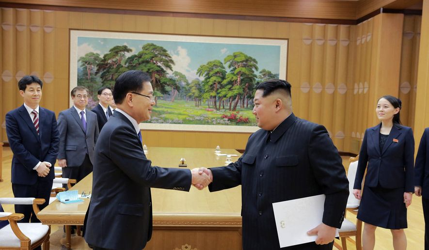 """FILE - In this March 5, 2018 file photo, provided by the North Korean government, North Korean leader Kim Jong Un, front right, shakes hands with South Korean National Security Director Chung Eui-yong after Chung gave Kim the letter from South Korean President Moon Jae-in, in Pyongyang, North Korea. South Korean President Moon Jae-in has always wanted to lead the diplomacy aimed at ending the North Korean nuclear crisis, even as he was overshadowed in his first year in office by a belligerent standoff between Donald Trump and Kim Jong Un. Independent journalists were not given access to cover the event depicted in this image distributed by the North Korean government. The content of this image is as provided and cannot be independently verified. Korean language watermark on image as provided by source reads: """"KCNA"""" which is the abbreviation for Korean Central News Agency. (Korean Central News Agency/Korea News Service via AP, File) **FILE**"""