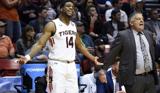 Auburn guard Malik Dunbar (14) reacts alongside head coach Bruce Pearl during the second half of a first-round NCAA college basketball tournament game against Charleston,Friday, March 16, 2018, in San Diego. (AP Photo/Denis Poroy)