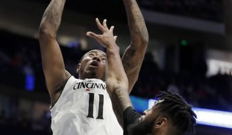Cincinnati forward Gary Clark (11) shoots over Georgia State forward Jordan Session (23) during a first-round game of the NCAA college basketball tournament in Nashville, Tenn., Friday, March 16, 2018. (AP Photo/Mark Humphrey)
