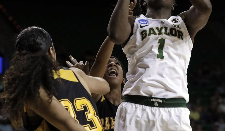 Grambling State forward Kailyn Gideon (33) defends as Baylor forward Dekeiya Cohen (1) goes up to shoot in the second half of a first-round game at the NCAA women's college basketball tournament in Waco, Texas, Friday, March 16, 2018. (AP Photo/Tony Gutierrez)