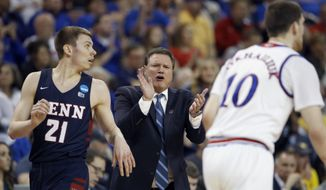 Kansas head coach Bill Self talks to his players during the first half of an NCAA college basketball tournament first-round game against Pennsylvania Thursday, March 15, 2018, in Wichita, Kan. (AP Photo/Charlie Riedel)