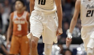 Nevada forward Caleb Martin (10) reacts after sinking a basket in overtime of a first-round game against Texas in the NCAA college basketball tournament in Nashville, Tenn., Friday, March 16, 2018. (AP Photo/Mark Humphrey)
