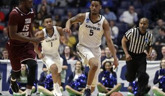 Xavier guard Trevon Bluiett (5) dribbles down court in the first half of a first-round game against Texas Southern in the NCAA college basketball tournament in Nashville, Tenn., Friday, March 16, 2018. (AP Photo/Mark Humphrey)