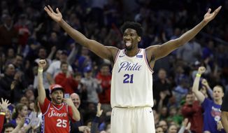 Philadelphia 76ers' Joel Embiid reacts after scoring a three-point basket during the second half of an NBA basketball game against the Brooklyn Nets, Friday, March 16, 2018, in Philadelphia. (AP Photo/Matt Slocum)