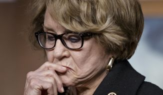 FILE - In this Jan. 21, 2015 file photo, Rep. Louise Slaughter, D-N.Y., pauses during a news conference on Capitol Hill in Washington.  An aide to Slaughter says the 88-year old Democratic congresswoman from upstate New York has died. (AP Photo/J. Scott Applewhite)