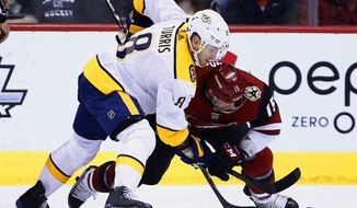 Nashville Predators center Kyle Turris (8) and Arizona Coyotes center Brad Richardson (15) vie for the puck after a faceoff during the second period of an NHL hockey game Thursday, March 15, 2018, in Glendale, Ariz. (AP Photo/Ross D. Franklin)