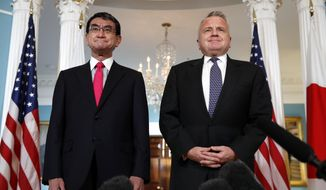 Japanese Foreign Minister Taro Kono, left, meets with Deputy Secretary of State John Sullivan, Friday, March 16, 2018, at the State Department in Washington. (AP Photo/Jacquelyn Martin)