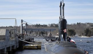 In this Thursday, March 15, 2018 photo, preparations are under way for the commissioning of the U.S. Navy Virginia-class attack submarine PCU (pre-commissioning unit) Colorado (SSN 788) at the naval submarine base in Groton, Conn. The submarine will be the USS Colorado and begins service Saturday, March 17, 2018, at the Naval Submarine Base in Groton. (Sean D. Elliot/The Day via AP)