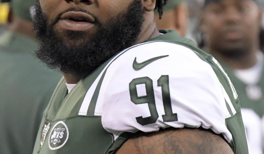 File-This Aug. 31, 2017, file photo shows New York Jets defensive end Sheldon Richardson walking on the sideline during the first half of an NFL football game in East Rutherford, N.J. The Minnesota Vikings have signed Richardson to bolster what was already one of the NFL's top defenses. Richardson, the 13th overall pick out of Missouri in 2013 by the Jets, had one sack and 27 tackles last season for Seattle. He spent his first four seasons with New York, which traded him last summer to the Seahawks for wide receiver Jermaine Kearse and a draft pick. The 27-year-old Richardson has 286 tackles and 19 sacks in his career.(AP Photo/Bill Kostroun, File)