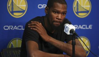 Golden State Warriors' Kevin Durant speaks during a media conference on Friday, March 16, 2018, in Oakland, Calif. Durant will miss 1-2 weeks to allow a rib injury to heal. (AP Photo/Ben Margot)