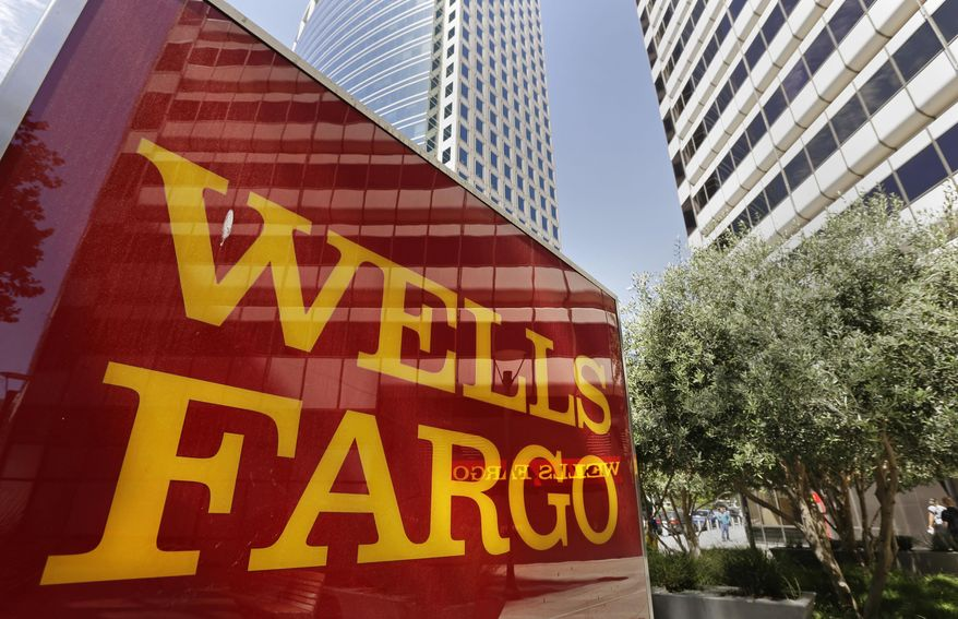 This July 14, 2014, file photo shows Wells Fargo offices in Oakland, Calif. (AP Photo/Ben Margot, File)
