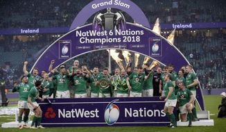 Ireland's players celebrate winning the Grand Slam after the Six Nations rugby union match against England at Twickenham stadium in London, Saturday, March 17, 2018. Ireland made it a St. Patrick's Day for the ages by claiming a rare Six Nations Grand Slam after stifling the old enemy England in a fabulous 24-15. (AP Photo/Tim Ireland)