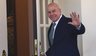 National security adviser H.R. McMaster waves as he walks into the West Wing of the White House in Washington, Friday, March 16, 2018. (AP Photo/Susan Walsh)