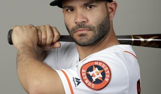 File-This is a 2018 photo  shows Jose Altuve of the Houston Astros baseball team. A person familiar with the negotiations says AL MVP Altuve and the World Series champion Astros have agreed to a contract that guarantees him an additional $151 million over five seasons from 2020-24. The person spoke to The Associated Press on condition of anonymity Friday, March 16, 2018, because the agreement had not been announced. (AP Photo/John Raoux, File)
