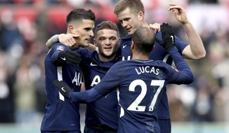 Tottenham Hotspur's Erik Lamela, left, celebrates scoring his side's second goal of the game against Swansea City with teammates during the English FA Cup, quarterfinal soccer match at the Liberty Stadium, Swansea, Wales, Saturday March 17, 2018. (Nick Potts/PA via AP)