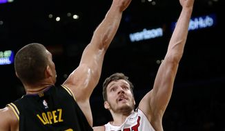 Miami Heat guard Goran Dragic, right, goes to the basket while defended by Los Angeles Lakers center Brook Lopez during the first half of an NBA basketball game Friday, March 16, 2018, in Los Angeles. (AP Photo/Ringo H.W. Chiu)