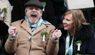 US actor Mark Hamill and his wife Marilou York attend the St Patrick's day parade, in Dublin, Saturday March 17, 2018. (Brian Lawless/PA via AP)