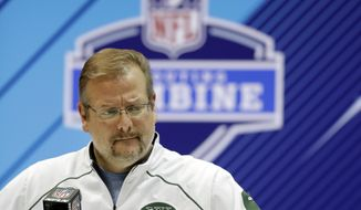 FILE - In this Feb. 28, 2018, file photo, New York Jets general manager Mike Maccagnan speaks during a press conference at the NFL football scouting combine in Indianapolis. The Jets have acquired the No. 3 overall pick in the NFL draft from the Indianapolis Colts on Saturday, March 17, 2018,, moving up three spots in a sign that they intend to get one of the top quarterbacks available. The Jets are sending the Colts their first-rounder, No. 6 overall ,along with two second-rounders this year and a second-rounder next year to complete the massive deal.  (AP Photo/Darron Cummings, File(