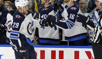 FILE - In this Jan. 9, 2018, file photo, Winnipeg Jets forward Patrik Laine (29) celebrates his goal with teammates during the first period of an NHL hockey game against the Buffalo Sabres in Buffalo, N.Y. With 16 goals and eight assists in his past 14 games, Laine has the longest point streak by a teenager and already passed Wayne Gretzky for the most goals by a player before turning 20. (AP Photo/Jeffrey T. Barnes, File)