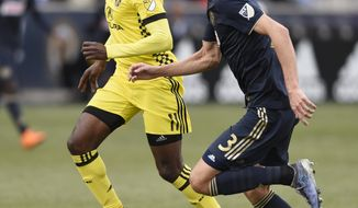 Columbus Crew's Gyasi Zardes (11) drives the ball past Philadelphia Union's Jack Elliott (3) in the second half of an MLS soccer match, Saturday, March 17, 2017, in Chester, Pa. The game ended 0-0. (AP Photo/Michael Perez)