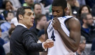 Villanova head coach Jay Wright, left, talks with Eric Paschall during the second half of a second-round game in the NCAA men's college basketball tournament against Alabama, Saturday, March 17, 2018, in Pittsburgh. Villanova won 81-58. (AP Photo/Keith Srakocic)