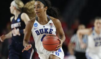 Duke guard Lexie Brown moves the ball down the court against Belmont during the second half of a first-round game in the NCAA women's college basketball tournament in Athens, Ga., Saturday, March. 17, 2018. Duke won 72-58. (AP Photo/Joshua L. Jones)