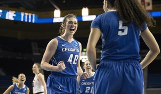 Creighton forward Ali Greene, center, celebrates as forward Jaylyn Agnew, right, scores a basket and draws a foul during the second half of a first-round game in the NCAA women's college basketball tournament against Iowa in Los Angeles, Saturday, March 17, 2018. (AP Photo/Kyusung Gong)