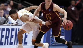 Tennessee guard James Daniel III (3) attempts a steal against Loyola-Chicago guard Clayton Custer (13), who maintained control of the ball during the first half of a second-round game at the NCAA men's college basketball tournament in Dallas, Saturday, March 17, 2018. (AP Photo/Tony Gutierrez)