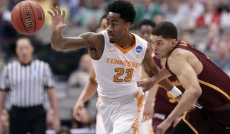 Tennessee guard Jordan Bowden (23) comes away with a steal against Loyola-Chicago guard Lucas Williamson, right, during the first half of a second-round game at the NCAA men's college basketball tournament in Dallas, Saturday, March 17, 2018. (AP Photo/Tony Gutierrez)