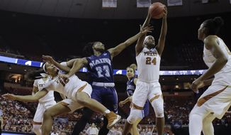 Texas forward Joyner Holmes (24) grabs a rebound over Maine guard Tanesha Sutton (23) and teammate Jada Underwood (12) during a first-round game in the NCAA women's college basketball tournament, Saturday, March 17, 2018, in Austin, Texas. (AP Photo/Eric Gay)