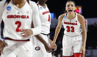 Georgia forward Mackenzie Engram (33) fires up her teammates guard Gabby Connally (2) and Georgia forward Caliya Robinson (4) during the first half against Mercer in a first-round game in the NCAA women's college basketball tournament in Athens, Ga., Saturday, March. 17, 2018. (AP Photo/Joshua L. Jones)