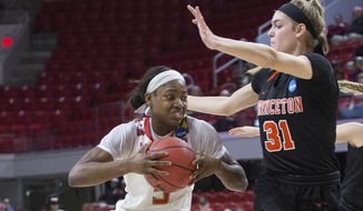 Maryland's Kaila Charles, left, drives against the defense of Princeton's Bella Alarie (31) during the first half of a first-round game in the NCAA women's college basketball tournament in Raleigh, N.C., Friday, March 16, 2018. (AP Photo/Ben McKeown) **FILE**
