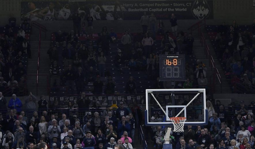 Connecticut's Molly Bent, left, holds the ball with 16.8 seconds left during a first-round game against Saint Francis (Pa.) in the NCAA women's college basketball tournament in in Storrs, Conn., Saturday, March 17, 2018. UConn won 140-52. (AP Photo/Jessica Hill)