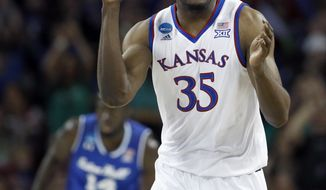 Kansas center Udoka Azubuike (35) celebrates after making a basket during the first half of an NCAA men's college basketball tournament second-round game against Seton Hall Saturday, March 17, 2018, in Wichita, Kan. (AP Photo/Charlie Riedel)