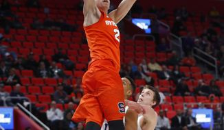 Syracuse forward Marek Dolezaj (21), of Slovakia, dunks against TCU during the second half of an NCAA men's college basketball tournament first-round game in Detroit, Friday, March 16, 2018. (AP Photo/Paul Sancya)
