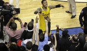 UMBC's Jairus Lyles (10) celebrates with fans after the team's 74-54 win over Virginia in a first-round game in the NCAA men's college basketball tournament in Charlotte, N.C., Friday, March 16, 2018. (AP Photo/Chuck Burton)