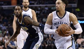 Memphis Grizzlies forward Dillon Brooks, right, drives against Denver Nuggets forward Will Barton during the first half of an NBA basketball game Saturday, March 17, 2018, in Memphis, Tenn. (AP Photo/Brandon Dill)