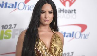 FILE - In this Dec. 1, 2017 file photo, Demi Lovato arrives at Jingle Ball at The Forum in Inglewood, Calif.  Lovato celebrated six years sober at a concert in New York with tour mate and DJ Khaled, whose powerful brought the pop star to tears. Lovato performed Friday, March 16, 2018  at the Barclays Center in Brooklyn, New York, telling the audience March 15 was a proud day for her. (Photo by Richard Shotwell/Invision/AP, File)